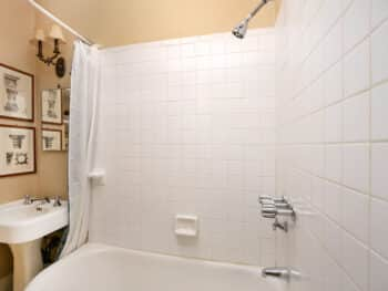 bathroom with white tile and pedestal sink