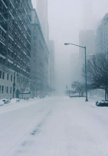 A foggy, snowy, & empty New York City street during the winter